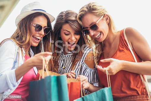 Three women shopping together.