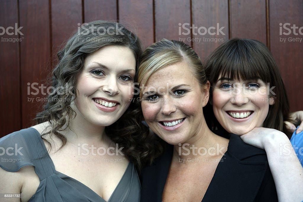 Three women smiling royaltyfri bildbanksbilder