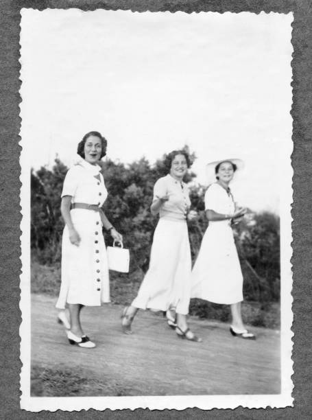 three women walking in 1934,black and white - 1930s style stock photos and pictures