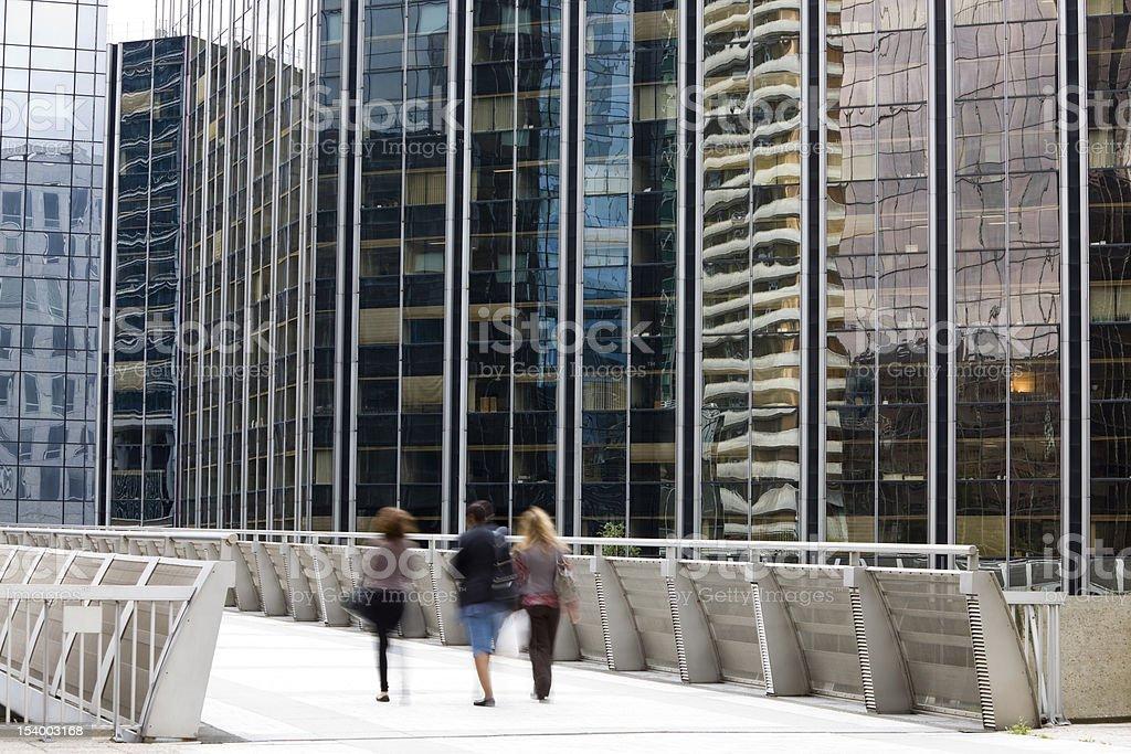 Three Women Walking in Financial District royalty-free stock photo