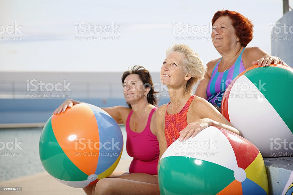 Three women with beach balls  royalty free stockfoto