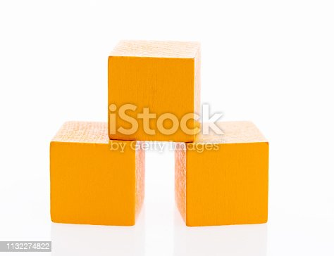 1134528355 istock photo Three wooden blocks on white background 1132274822