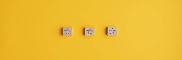 Three wooden blocks with star shape on them placed in a row stock photo