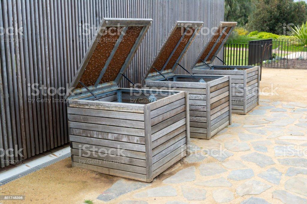 Three Wooden Composting Bins stock photo