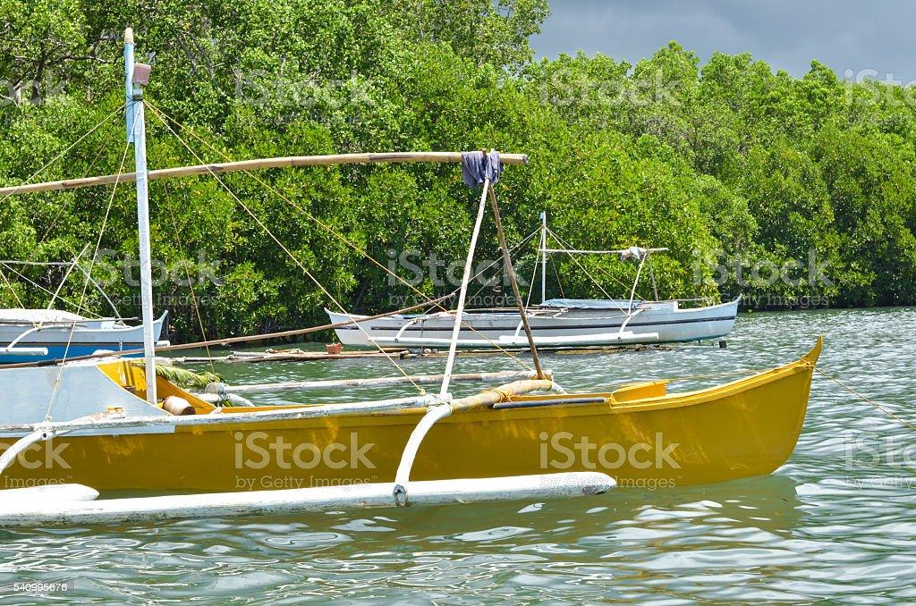 Three wooden fishing boats photo stock photo