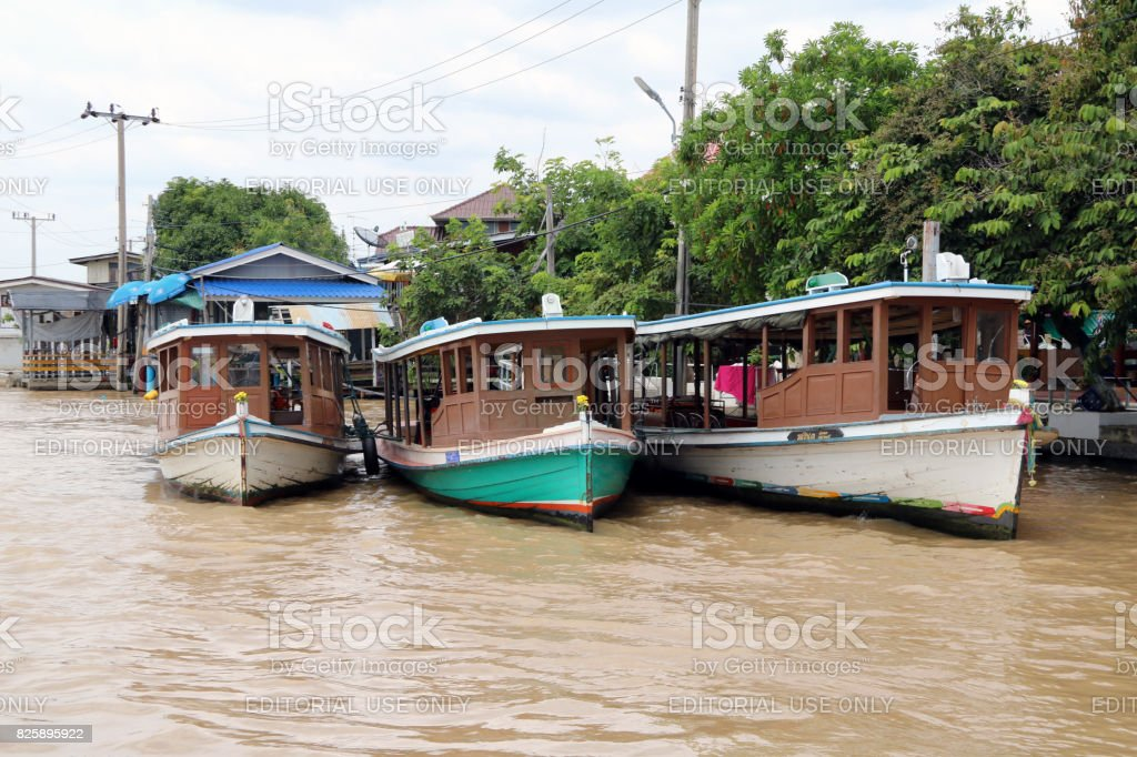 Three wooden Passenger boat in Chao Phraya river. stock photo