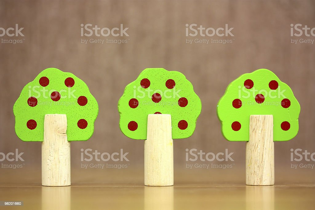 Three wooden toy trees royalty-free stock photo