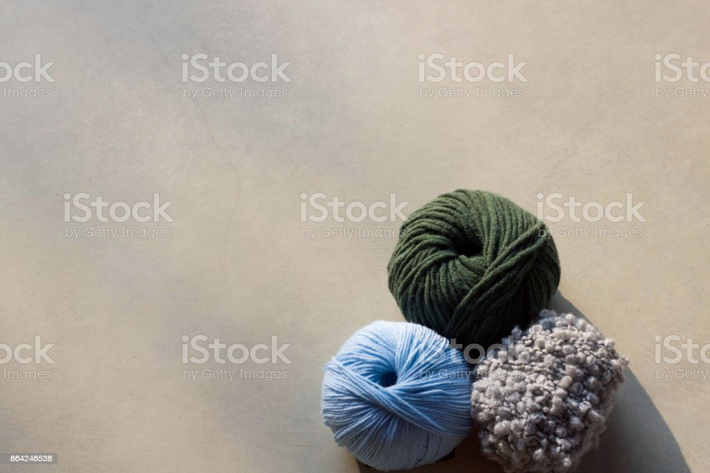 three woolen threads in different color, copy space. royalty-free stock photo