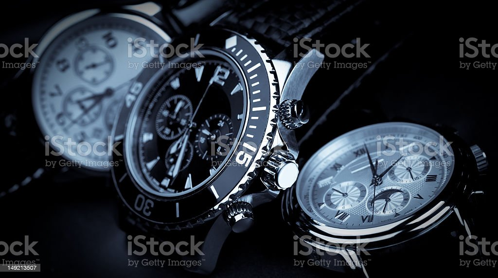 Three wrist watches displayed beside one another stock photo