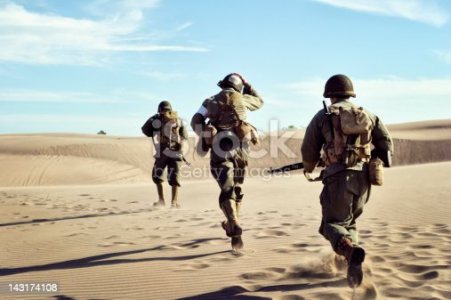 istock Three WWII Soldiers Running In The Desert Sand 143174108