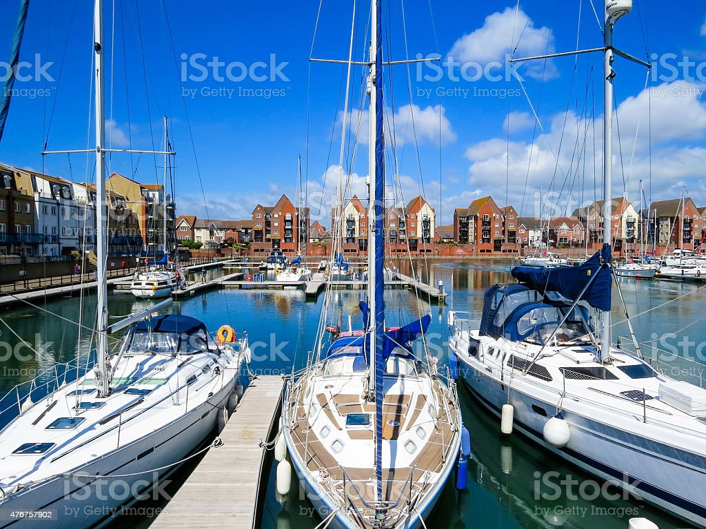 Three Yachts moored in the Sovereign Harbour Marina, Eastbourne stock photo