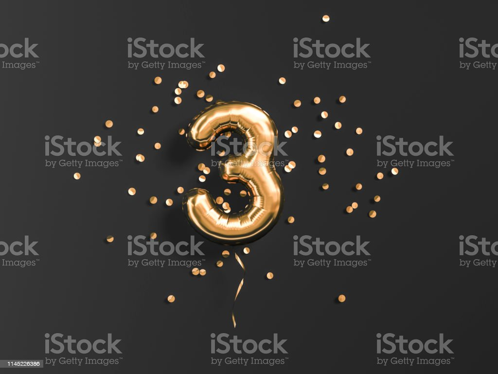 Three year birthday. Number 3 flying foil balloon and gold confetti...