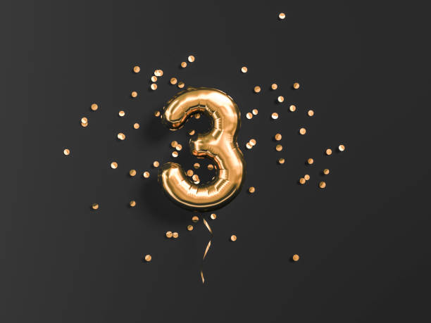 three year birthday. number 3 flying foil balloon and gold confetti - terceira imagens e fotografias de stock
