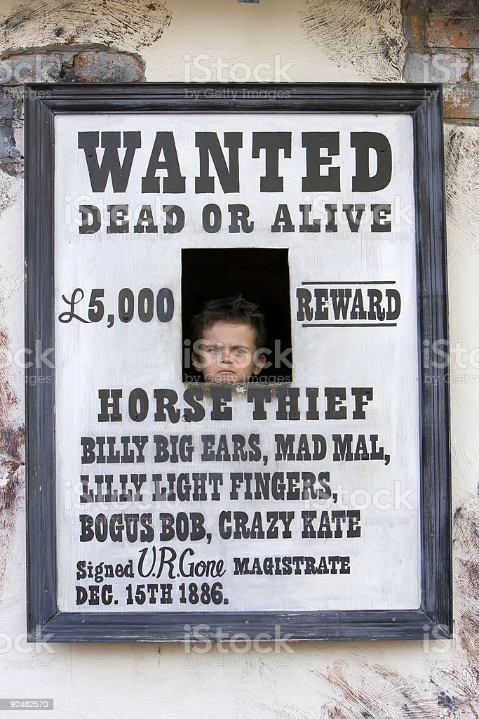 Three year old kid in wanted poster royalty-free stock photo