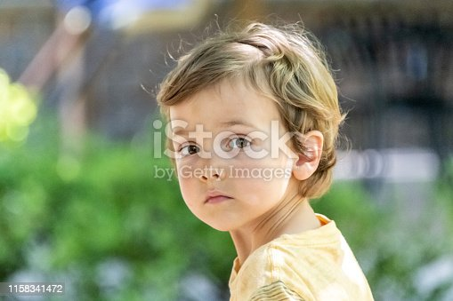 Caucasian Three years old child boy looking at the camera