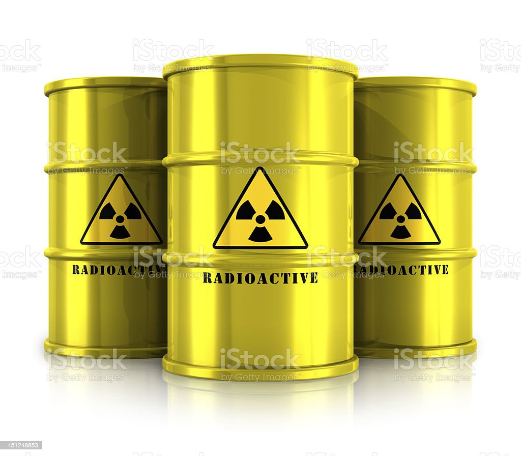 Three yellow barrels with radioactive waste stock photo