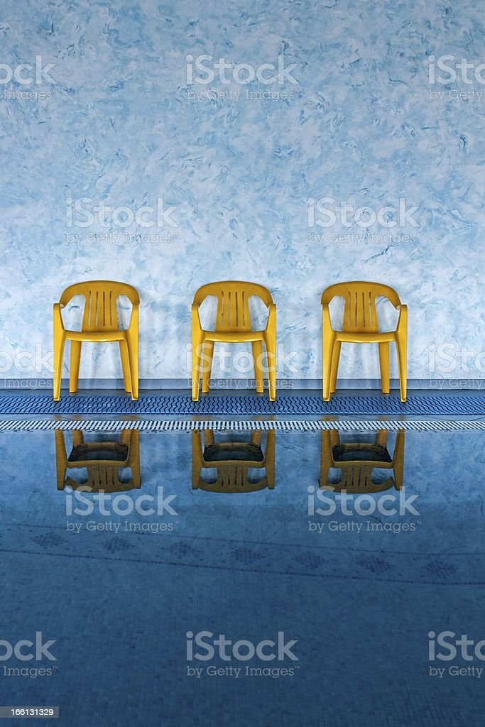 three yellow chairs at the swimming pool royalty-free stock photo