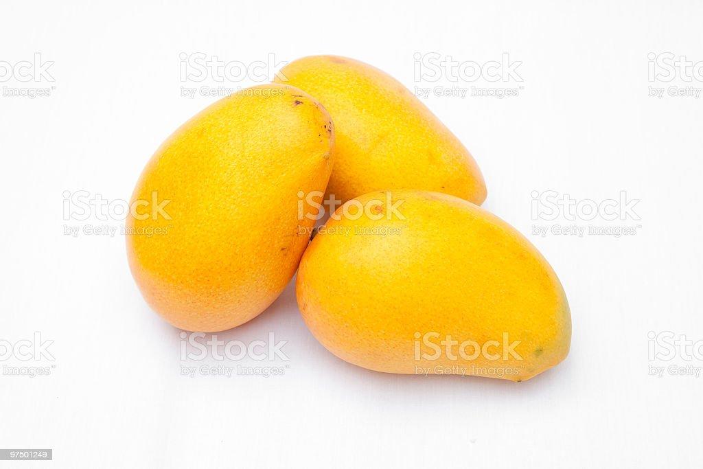 Three yellow mangoes ready to eat royalty-free stock photo