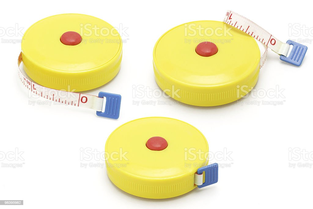 Three yellow plastic measuring tapes royalty-free stock photo