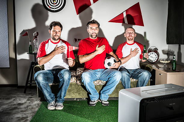 three young adult men friends watching football: national anthem pride - national anthem stock photos and pictures