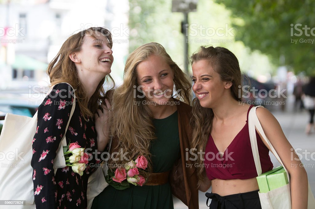 Three young and beautiful friends laughing royalty-free stock photo