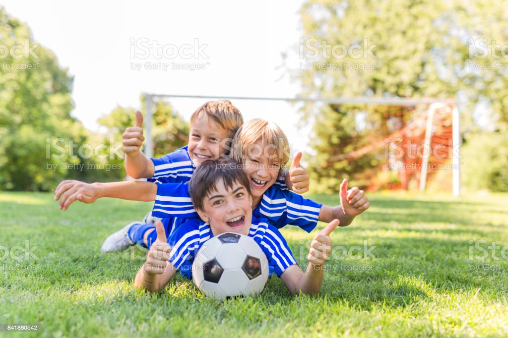three, Young boy with soccer ball on a sport uniform stock photo