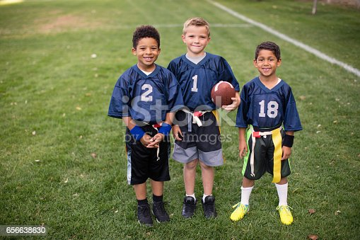 istock Three Young Boys and Teammates Play Flag Football 656638630