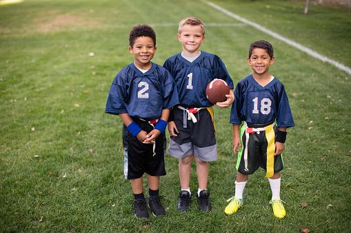 istock Three Young Boys and Teammates Play Flag Football 656638630