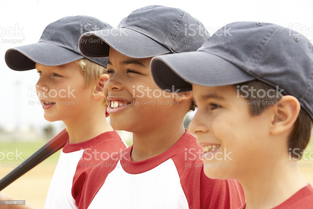 Three young boys in a Baseball team standing in a line royalty-free stock photo