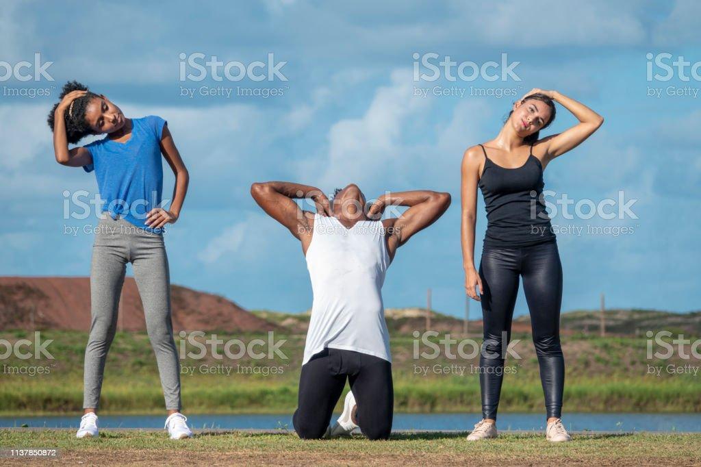Three Young Brazilian Adults Making Gymnastic Outside Stock ...