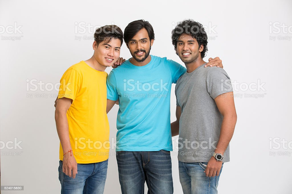 Three young cheerful friends posing in casual wear stock photo