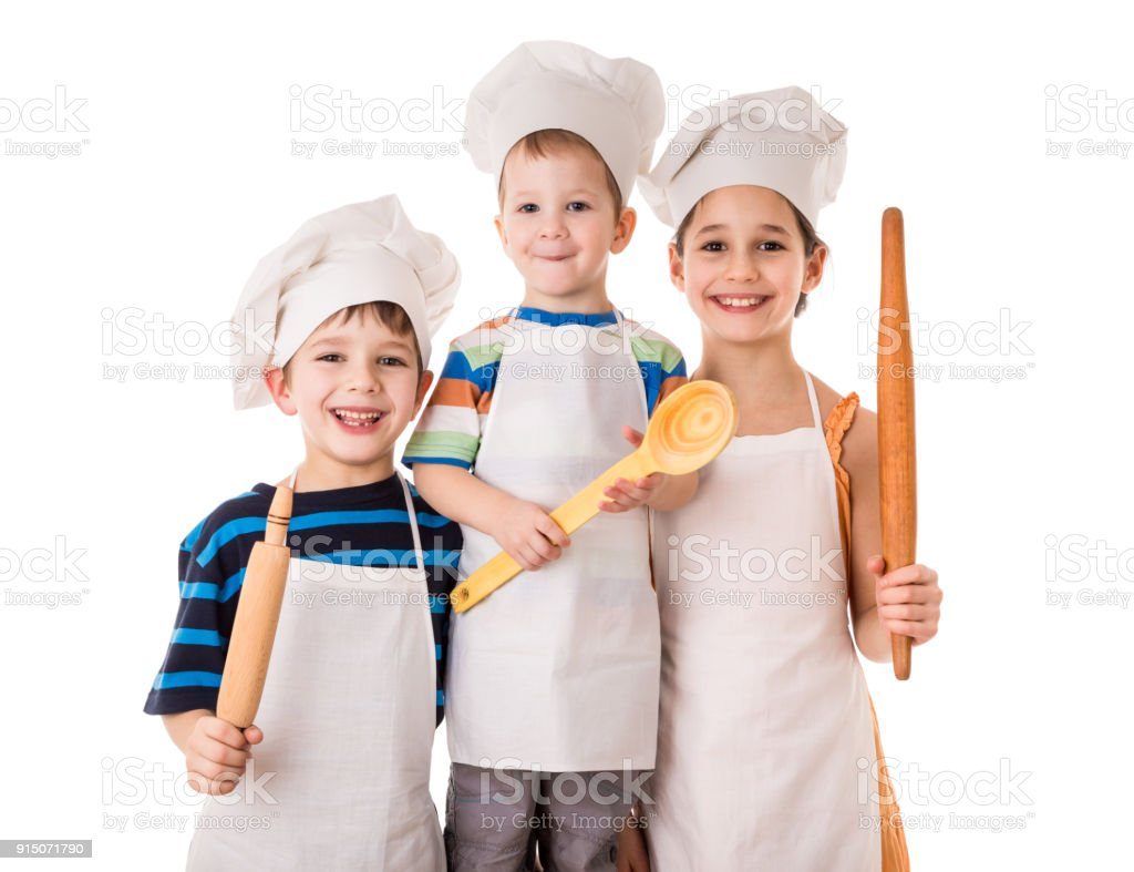 Three young chefs standing together with ladle and rolling pin stock photo