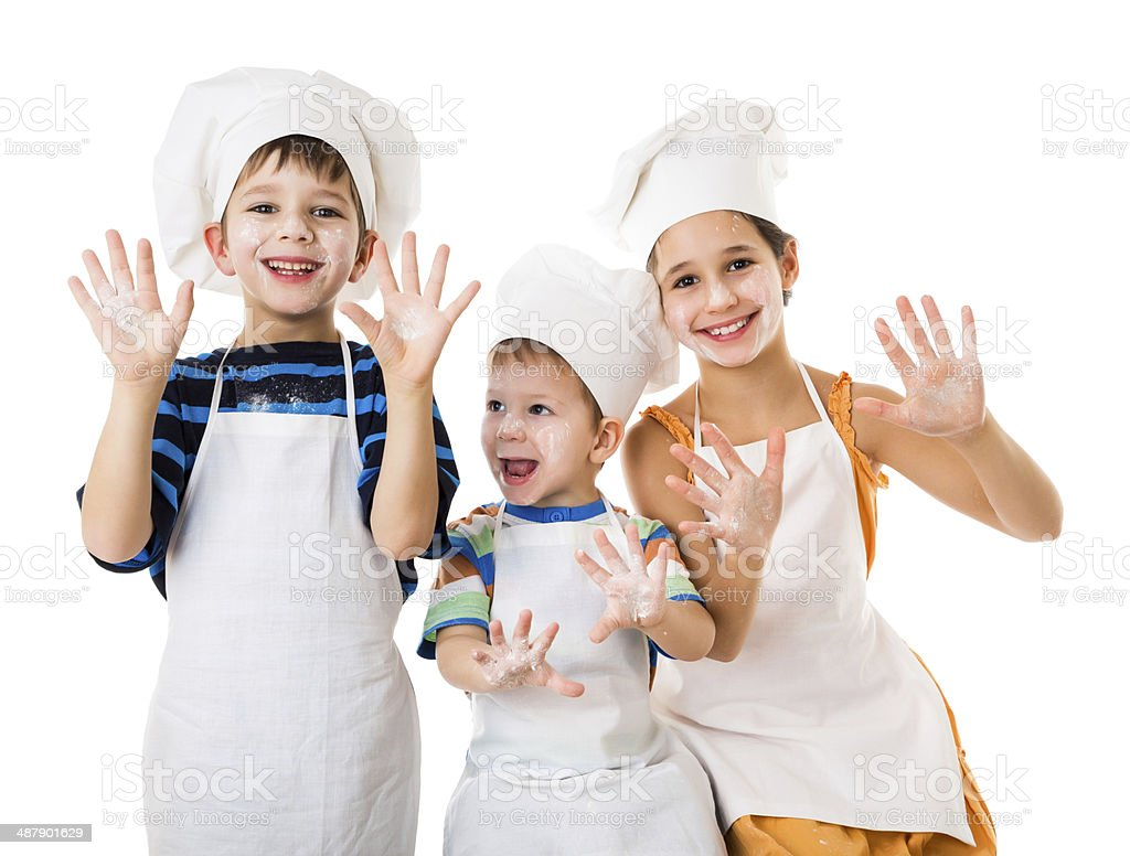 Three young chefs with hands in flour stock photo