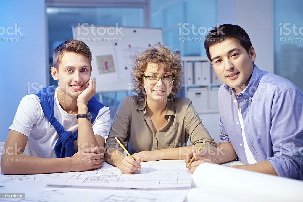 Three young designers royalty-free stock photo