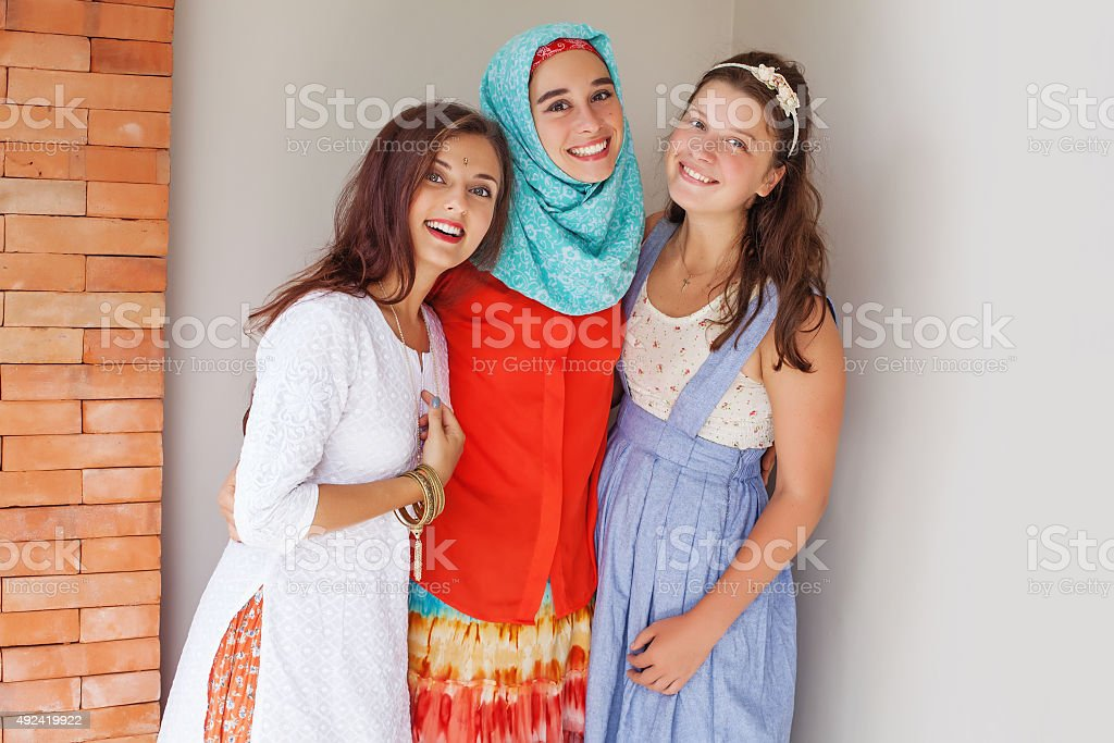 three young friends of different religions stock photo
