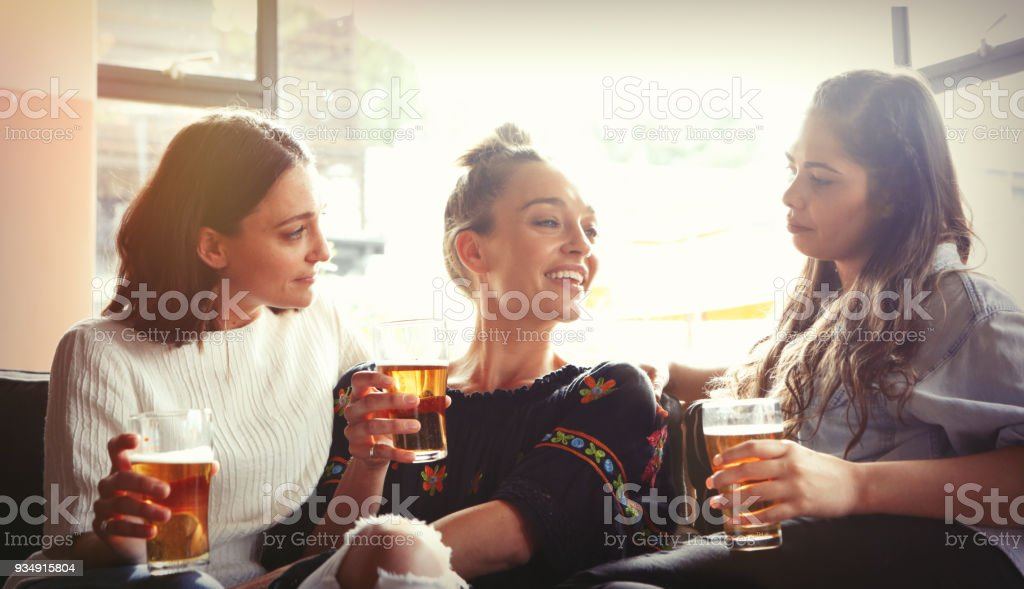 Three young girls having fun together in the restaurant stock photo