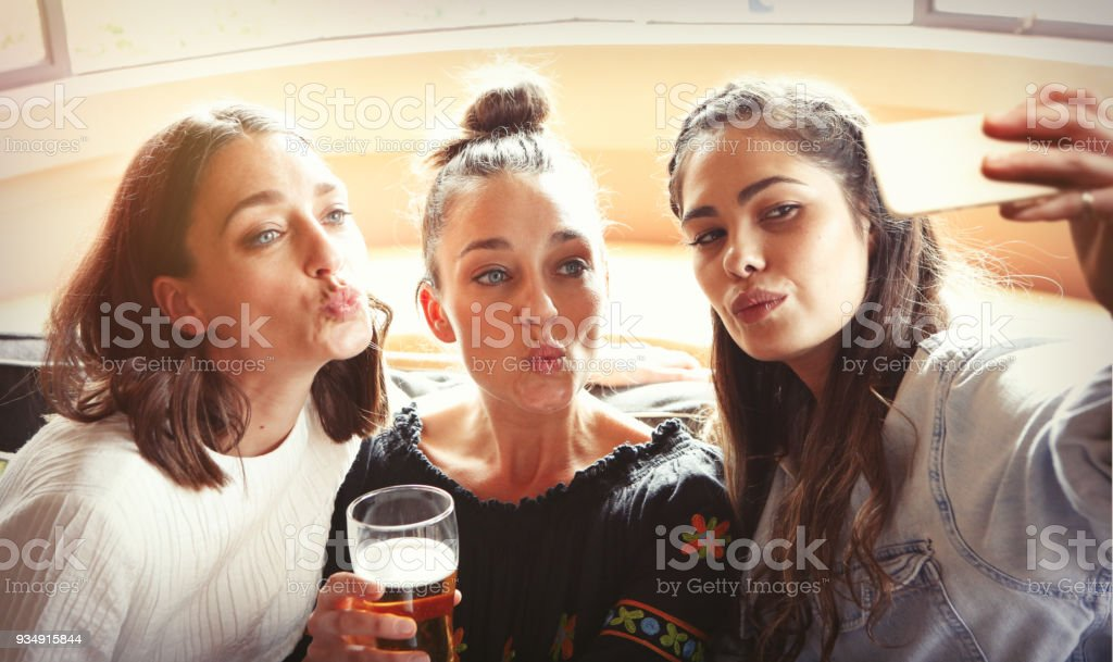 Three young girls taking selfie stock photo