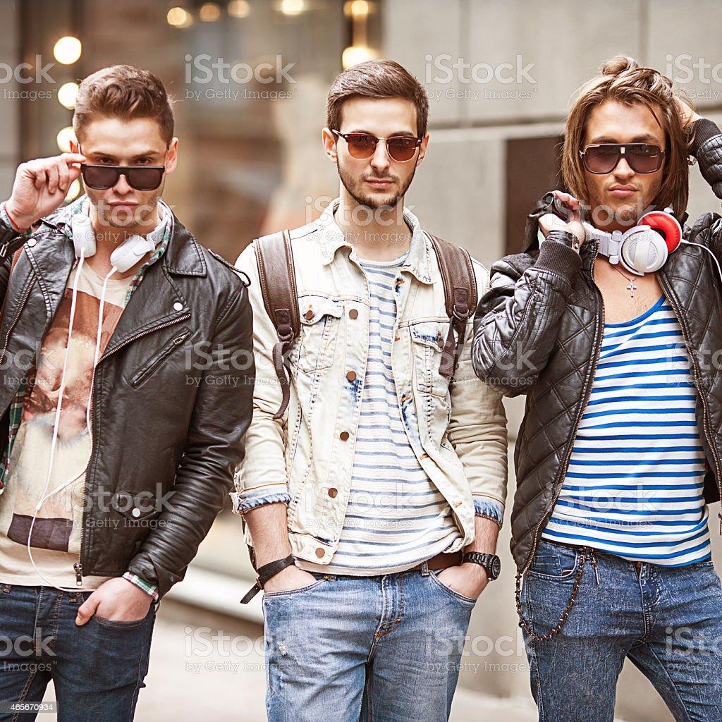 Three Young male fashion metraseksuals shop shopping walk stock photo