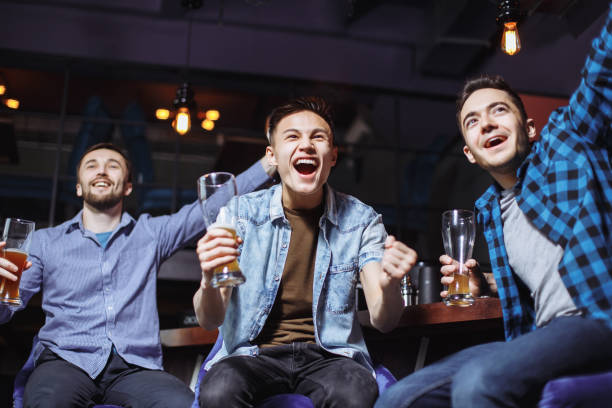 Three young men in casual clothes are cheering for football and of picture id1072419814?b=1&k=6&m=1072419814&s=612x612&w=0&h=cu1d8wmauohw1lurvjf3b5rvaj6l759iclapglb2z9w=