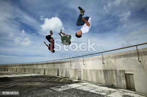 istock Three young men to turn somersaults 829648204