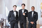 istock Three young men wearing tuxedos 639247682
