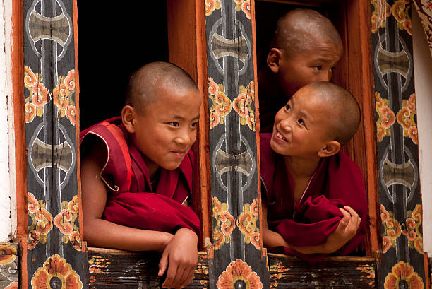 Three young monks in Bhutan