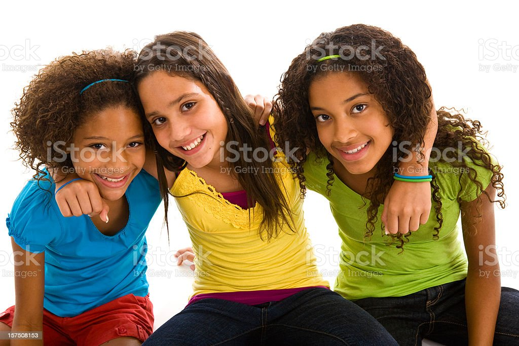 Three young multi-ethnic girls teenagers hugging stock photo