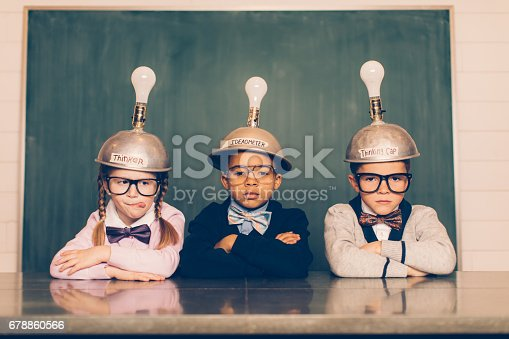 istock Three Young Nerds with Thinking Caps 678860566