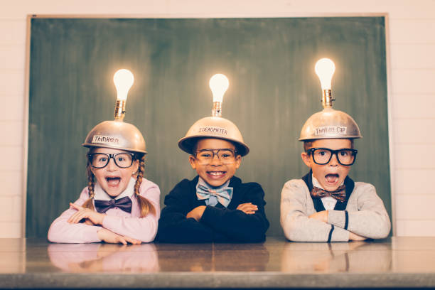 three young nerds with thinking caps - humor stock photos and pictures