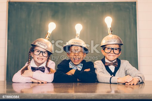 istock Three Young Nerds with Thinking Caps 678860584