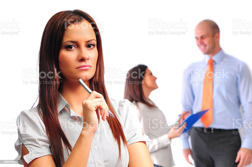 Three young professionals, two businesswomen and businessman in professional challenge royalty-free stock photo