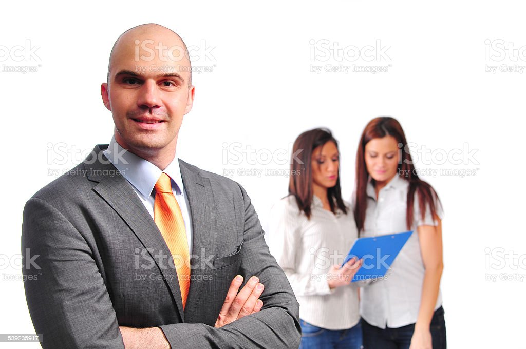 Three young professionals, two businesswomen and manager businessman in teamwork royalty-free stock photo