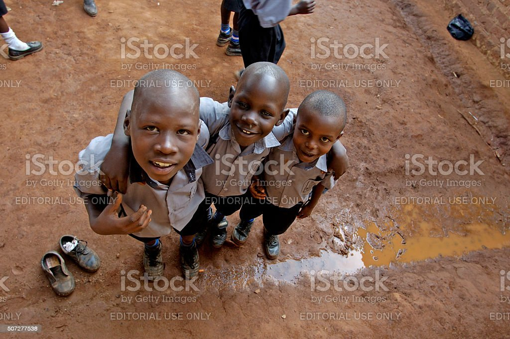 Three young schoo lfriends are playing outside. stock photo