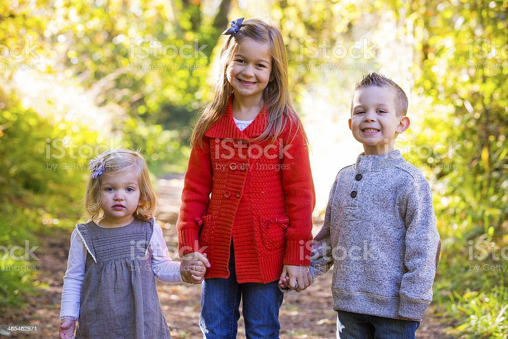Three Young Siblings stock photo